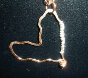 Hammered copper heart with sterling silver.