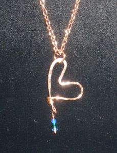 Hammered copper with blue and green crystal drop.