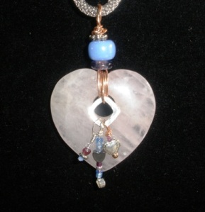 Agate heart with lampworked bead, hematite, crystal, garnet, sterling, copper,sterling silver.