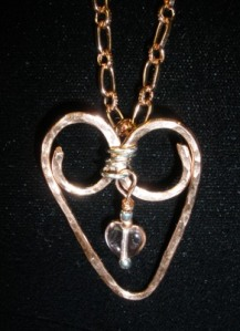 Hammered copper heart with fine silver and peach drop.