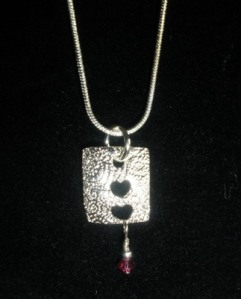 Fine silver with crystal.