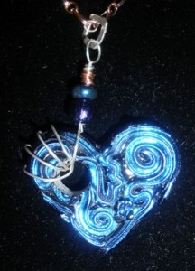 Dichroic glass heart with silver and copper.