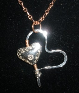 Double heart pendant with sterling and Thai silver and copper.