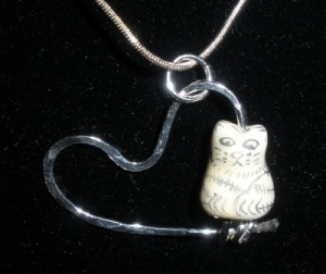 Ceramic kitty on silver heart pendant.